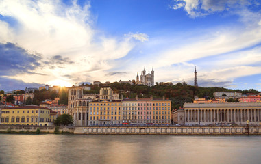 Fotomurales - Colorful sunset at Vieux Lyon and Fourviere Basilica seen from the riverbank of the Saone, Lyon.