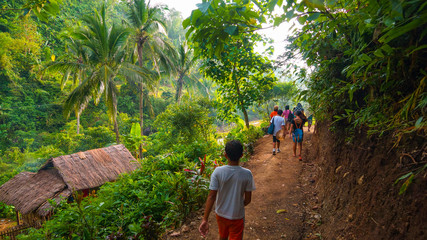 Local village hikers on lush jungle trail - Panay, Philippines