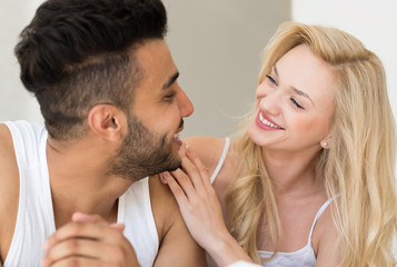 Young Couple Lying In Bed Looking At Each Other, Happy Smile Hispanic Man And Woman Closeup