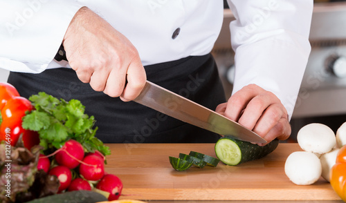 """Chef chopping vegetables"" Stock photo and royalty-free ..."