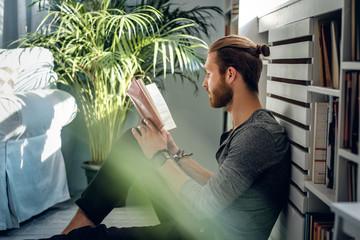 A man reading a book.