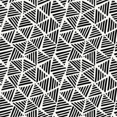 Abstract seamless pattern with geometric shapes in black and white.