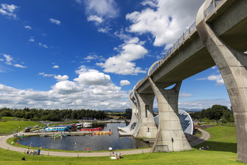Falkirk Wheel with blue sky in Falkirk Scotland. The Wheel is a rotating boat lift connecting the Forth and Clyde Canal with the Union Canal