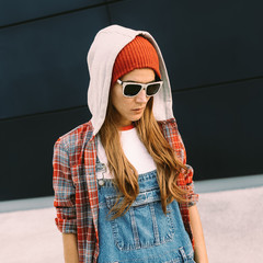 Stylish Girl Student. Autumn urban.Denim overalls and red access