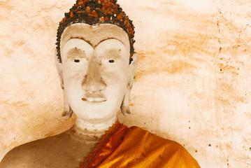 Face of Buddha statue and thai art architecture in Wat Aranyikawat, Ratchaburi , Thailand