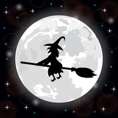 witch on a background of the full moon