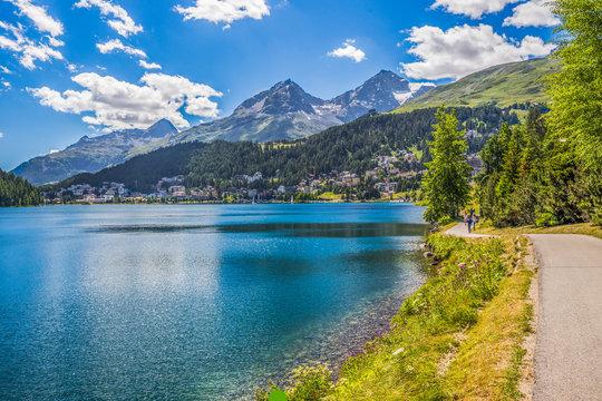 People walking along Lake Sankt Moritz in Swiss Alps