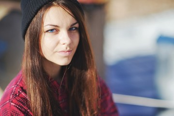 portrait of a beautiful teen girl with blue eyes wearing  red sh