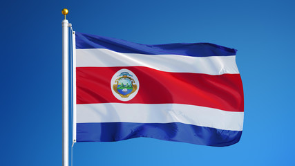 Costa Rica flag waving against clean blue sky, close up, isolated with clipping path mask alpha channel transparency