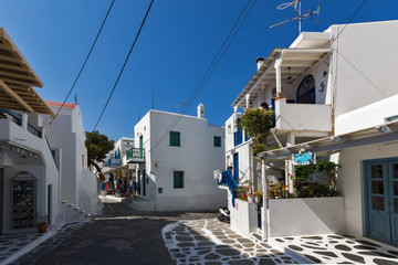 Street with white houses in town of Mykonos, Cyclades Islands, Greece