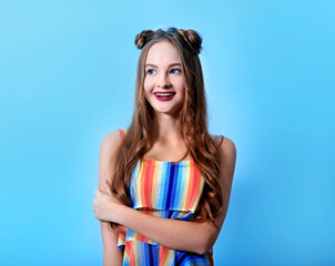 Beautiful teenager girl on blue wall background