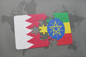 puzzle with the national flag of bahrain and ethiopia on a world map background.
