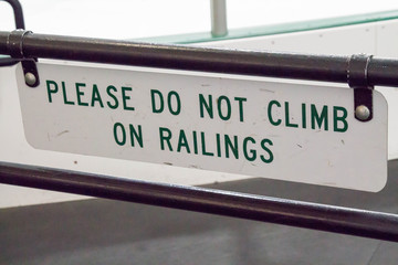 Sign that says Please do not climb on railings