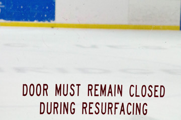 Door must remain closed during resurfacing etching on glass at a hockey rink