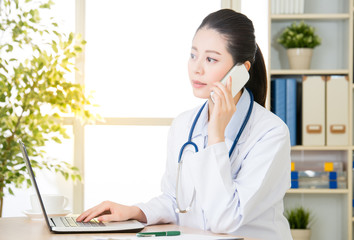 Doctor explain patient's condition by smart phone and computer