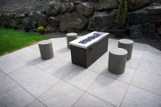 modern backyard fire pit with seating