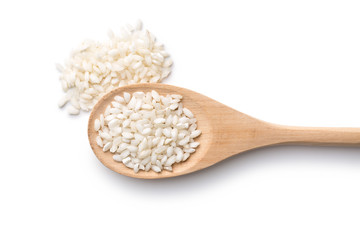 The arborio rice in wooden spoon.
