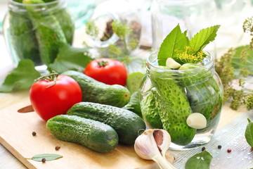 Homemade pickles in jar. Preserving pickled cucumbers.