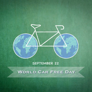 World car free day on September 22 announcement message with chalk drawing bicycle and world bike wheels on green chalkboard background: Care free day sign/ symbol ca