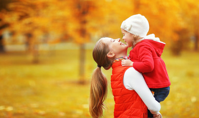 happy family. mother and child little daughter play kissing on a