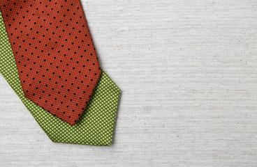 Green and red necktie design on canvas background