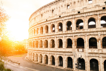 Ancient colosseum in Rome under the autumn sunset light