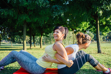 Happy women doing exercises together