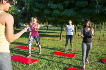 Group of women training with dumbbells