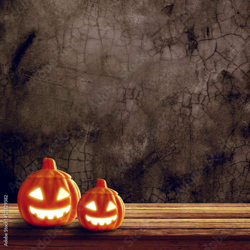 Halloween pumpkin on table wood with concrete wall background, halloween background concept, copy space.