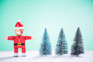 Funny Santa Claus and Christmas tree in snow