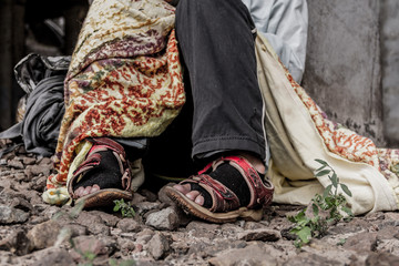 Close-up shooting of homeless woman's shoes