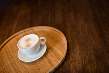 cup on wooden background