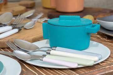 new modern cast iron cauldron and kitchen appliances