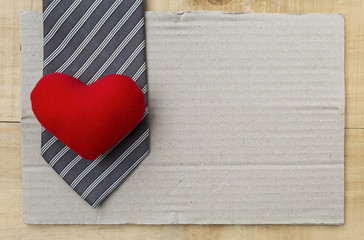 Red heart on necktie with space on brow paper, happy father's day card concept