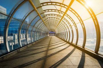 Wall Murals Tunnel Empty tunnel with footpath lit by sunset