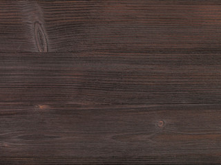 Wall Mural - wooden surface of dark brown color close up
