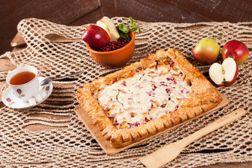 Pie on the table with food set