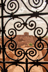 Moroccan tipical kasbah beyond window grate