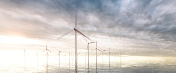 Image of coastal wind park with sunset stormy sky