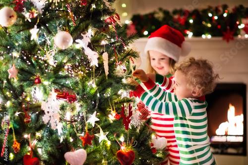 Kids decorating Christmas tree\