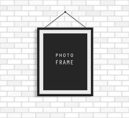Black photo frame on white brick wall