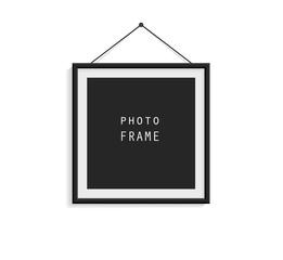 Black photo frame on gray wall