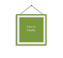 Green photo frame on gray wall