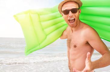 Happy man with swimming mattress