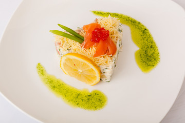 Salad with red fish and caviar