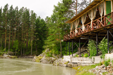 River Katun in Altai mountains, wooden terrace above river, beautiful forest