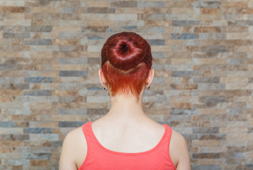 model with topknot and hidden undercut