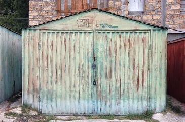 old rusty green metal car garage box