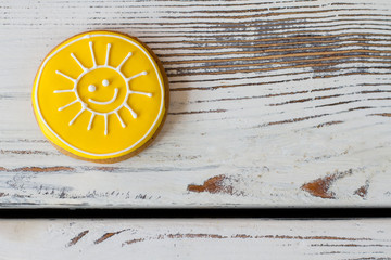 Yellow sun cookie. Round biscuit with glaze. Let this day be brighter. Simple dessert cooked at home.