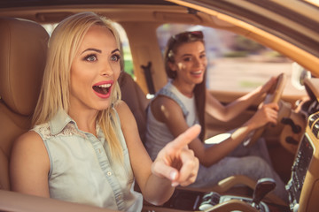Girls driving the car